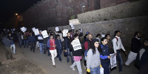 NEW DELHI, INDIA - FEBRUARY 12: JNU teachers and students protest march inside JNU Campus against arrest of JNU students union president Kanhaiya Kumar on February 12, 2016 in New Delhi, India. JNU students union president Kanhaiya Kumar was arrested on in connection with a case of sedition and criminal conspiracy over holding of an event at the prestigious institute against hanging of Parliament attack convict Afzal Guru in 2013. A group of students on Tuesday held an event on the JNU campus and allegedly shouted slogans against India. (Photo by Arun Sharma/Hindustan Times via Getty Images)