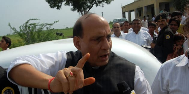 ALIGARH, INDIA � AUGUST 16: BJP leader Rajnath Singh meets the farmers during a demonstration demanding higher compensation for their land acquired for development of Yamuna Expressway on Monday, August 16, 2010. At Least three farmers were killed in police firing while an officer of the PAC was beaten to death by an angry mob in clashes.(Photo by K Asif/India Today Group/Getty Images)
