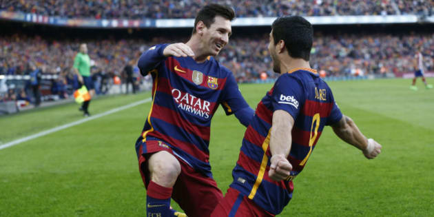 FC Barcelona's Luis Suarez, right, reacts after scoring with his teammate Lionel Messi against Atletico Madrid during a Spanish La Liga soccer match at the Camp Nou stadium in Barcelona, Spain, Saturday, Jan. 30, 2016. (AP Photo/Manu Fernandez)