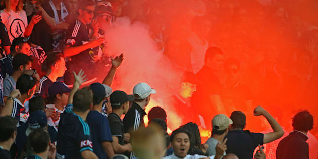 MELBOURNE, AUSTRALIA - FEBRUARY 13:  A flare is ignited in the Melbourne Victory supporters area of the crowd during the round 19 A-League match between Melbourne City FC and Melbourne Victory at AAMI Park on February 13, 2016 in Melbourne, Australia.  (Photo by Scott Barbour/Getty Images)