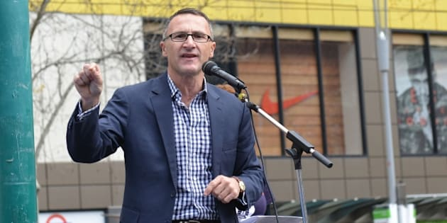 MELBOURNE, AUSTRALIA - SEPTEMBER 12: Leader of the parliamentary caucus of the Australian Greens Richard Di Natale delivers a speech during a demonstration to protest accepting so few Syrian and Iraqi refugees in Melbourne, Australia on September 12, 2015. (Photo by Recep Sakar/Anadolu Agency/Getty Images)