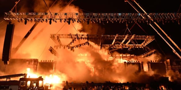 MUMBAI, INDIA - FEBRUARY 14: A massive fire broke out during a 'Make in India week' cultural programme at Maharashtra Night at Girgaum Chowpatty on February 14, 2016 in Mumbai, India. The fire broke out almost 10 minutes after Maharashtra CM Devendra Fadnavis delivered his speech at the event, during a lavani performance. The stage collapsed under the impact of the fire. However, no casualties were reported and the venue, at the Girgaum Chowpatty area, was evacuated very soon. Around 16 fire tenders put out the fire in 10 minutes. No casualties have been reported yet. Prime Minister Modi had inaugurated the Make in India Week yesterday as a showcase event for the government's flagship manufacturing scheme. (Photo by Kunal Patil/Hindustan Times via Getty Images)