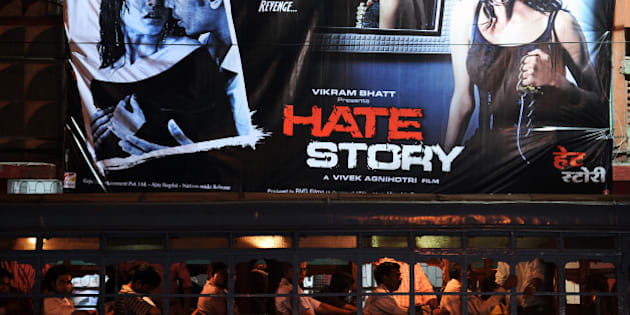 A passenger bus (bottom) drives past a banner for the film Hate Story hung outside a cinema hall in Kolkata on April 19, 2012. Two versions of promotional posters for the film 'Hate Story' are being painted blue in Kolkata  following orders of the Calcutta High Court, to hide the bare back of Bengali actress Paoli Dam which were deemed 'obscene and provocative' by the West Bengal Board of Censorship, a report said. AFP PHOTO/Dibyangshu SARKAR (Photo credit should read DIBYANGSHU SARKAR/AFP/Getty Images)