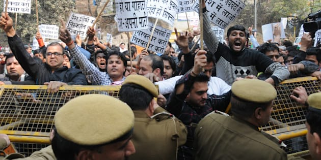 NEW DELHI, INDIA - FEBRUARY 12: Police trying to stop residents of nearby Munirka Village during demonstration against the organisers of the event on Afzal Guru where anti-national slogans were raised at JNU Campus on February 12, 2016 in New Delhi, India. JNU students' Union President Kanhaiya Kumar was arrested on in connection with a case of sedition and criminal conspiracy over holding of an event at the prestigious institute against hanging of Parliament attack convict Afzal Guru in 2013. A group of students on Tuesday held an event on the JNU campus and allegedly shouted slogans against India. (Photo by Arun Sharma/Hindustan Times via Getty Images)