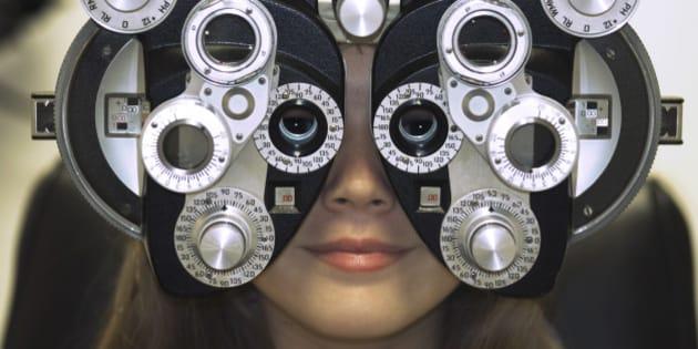 Woman's Face Behind Eye Exam Machine