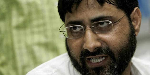NEW DELHI, INDIA:  Indian university professor S.A.R. Geelani gestures as he addresses a press conference in New Delhi, 04 August 2005.  India's Supreme Court confirmed the death penalty of Mohammad Afzal who was convicted in a December 2001 attack on India's parliament that pushed nuclear rivals India and Pakistan to the brink of war. The sentence of Shaukat Hussain who was convicted and sentenced to death by a high court was commuted to 10 year in prison. His wife and Delhi University Professor Geelani had lower court acquittals upheld by the Supreme Court, Press Trust of India said.Five armed rebels stormed the parliament on 13 December 2001, killing eight police officers and a gardener before they were shot dead by security forces. A journalist wounded in the attack died months later of his wounds. AFP PHOTO/Prakash SINGH  (Photo credit should read PRAKASH SINGH/AFP/Getty Images)