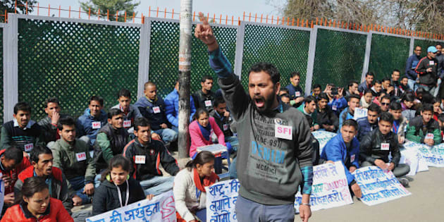 Indian students hold placards during a protest against the arrest of the president of Jawaharlal Nehru University's Student Union (JNU) Kanhaiya Kumar, at Himachal Pradesh University in Shimla on February 15, 2016. Violence broke out February 15 at a New Delhi court where a university student leader was due to appear on a sedition charge, in a case that has triggered protests in India. Television footage showed unidentified men punching and shoving journalists and students from Delhi's prestigious Jawaharlal Nehru University (JNU) as they gathered to attend Kanhaiya Kumar's hearing. AFP PHOTO / STR / AFP / STRDEL        (Photo credit should read STRDEL/AFP/Getty Images)