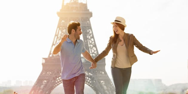Young couple walking together in Paris