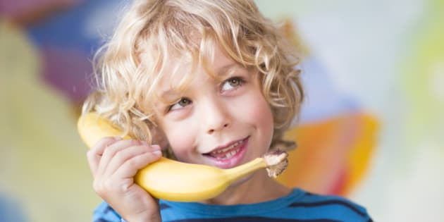 SANKT AUGUSTIN, GERMANY - AUGUST 05: Portrait of a six-year-old boy with blond curls talking on the banana phone on August 05, 2014, in Sankt Augustin, Germany.  Photo by Ute Grabowsky/Photothek via Getty Images)***Local Caption***
