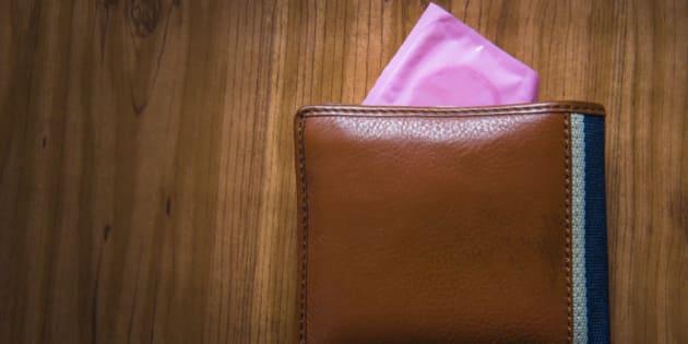 Condom put inside man wallet, Save sex concept