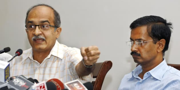 Prashant Bhushan, left, and Arvind Kejriwal, associates of Anna Hazare, India's most prominent anti-corruption activist, elaborate evidences of corruption collected against 15 ministers serving in the present government, including its leader and Prime Minister Manmohan Singh, at a press conference in New Delhi, India, Saturday, May 26, 2012. Files containing evidences of corruption have been sent to Singh, asking him to constitute an investigation team of eminent judges to verify their claims. (AP Photo/ Saurabh Das)