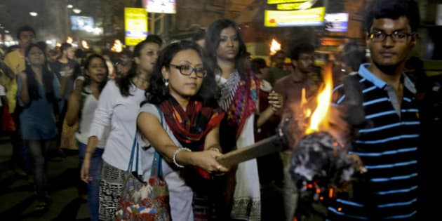 Students of Jadavpur University march in a torch light procession protesting against the arrest of a student union leader of New Delhi's Jawaharlal Nehru University in Kolkata, India, Tuesday, Feb. 16, 2016. Students, journalists and teachers protested in the Indian capital Tuesday after a student union leader's arrest and subsequent violence by Hindu nationalists. (AP Photo/ Bikas Das)