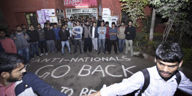NEW DELHI, INDIA - FEBRUARY 12: ABVP students protest against the organisers of the event on Afzal Guru where anti-national slogans were raised at JNU Campus on February 12, 2016 in New Delhi, India. JNU students' Union President Kanhaiya Kumar was arrested on in connection with a case of sedition and criminal conspiracy over holding of an event at the prestigious institute against hanging of Parliament attack convict Afzal Guru in 2013. A group of students on Tuesday held an event on the JNU campus and allegedly shouted slogans against India. (Photo by Arun Sharma/Hindustan Times via Getty Images)