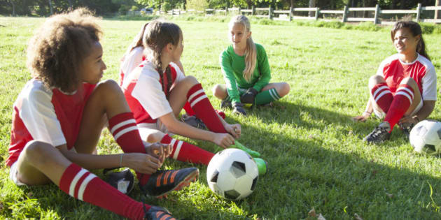 Girls soccer team (aged 12-13) preparing for a match
