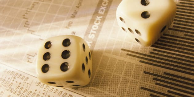 Dice on stock market report, close-up