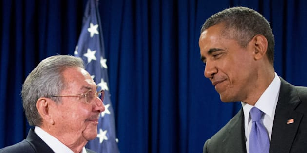 FILE - In this Sept. 29, 2015 file photo, President Barack Obama stands with Cuba's President Raul Castro before a bilateral meeting at the United Nations headquarters. The president is now staring down 11 months before his successor is chosen in an election shaping up to be a referendum on his leadership at home and abroad. He stirs deep anger among many Republicans, a constant reminder of his failure to make good on campaign promises to heal Washington's divisiveness. But he remains popular among Democrats and foresees a role campaigning for his party's nominee in the general election. (AP Photo/Andrew Harnik, File)