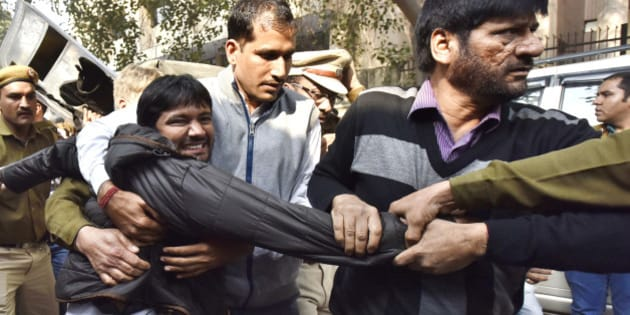 NEW DELHI, INDIA - FEBRUARY 17: JNU Students' Union President Kanhaiya Kumar being taken to Patiala House Court on February 17, 2016 in New Delhi, India. A bail hearing for JNUSU President Kanhaiya Kumar, who was arrested for sedition, descended into chaos on Wednesday as protesting lawyers chanting pro-government slogans barged into a courthouse compound. Delhi's Patiala House Court on Wednesday sent JNU student union leader Kanhaiya Kumar to judicial custody till March 2. JNU has been on the boil over the arrest of its student's Union President Kanhaiya Kumar on sedition charges after some students organised a meet to mark the anniversaries of executions of Parliament attack convict Afzal Guru. (Photo by Virender Singh Gosain/Hindustan Times via Getty Images)