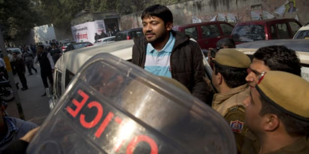 Kanhaiya Kumar, the president of the students' union at the country's premier Jawaharlal Nehru University is produced at a Delhi court, in New Delhi, India, Wednesday, Feb. 17, 2016. Dozens of lawyers, many with links to India's ruling nationalist party, clashed Wednesday with protesters demanding the release of the student leader arrested under India's colonial-era sedition laws. (AP Photo/Tsering Topgyal)