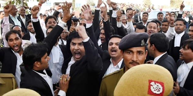 NEW DELHI, INDIA - FEBRUARY 15: A group of lawyers allegedly thrashed protesters and journalists inside the Patiala House Court premises on Monday afternoon, on February 15, 2016 in New Delhi, India. The students and journalists had gone to the court for the bail hearing of JNUSU President Kanhaiya Kumar, who has been arrested on charges of sedition for allegedly raising anti-India slogans. The escalating stand-off over the arrest of Kanhaiya Kumar on sedition charges today saw the students going on strike demanding his immediate release. Scuffle broke out in Patiala House court when JNUSU President Kanhaiya Kumar was being produced. The court ruled that JNUSU President Kanhaiya Kumar will stay in custody for two more days. (Photo by Sonu Mehta/Hindustan Times via Getty Images)