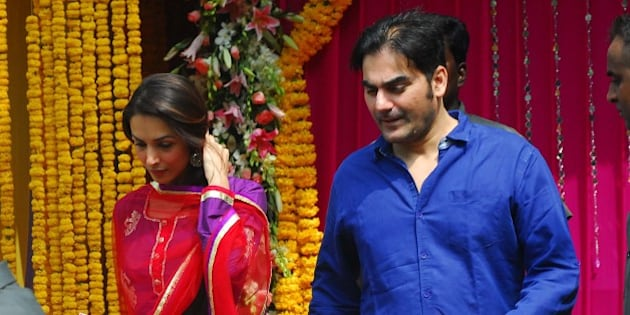 MUMBAI, INDIA - SEPTEMBER 10: Arbaaz Khan with wife Malaika Arora Khan during Ganpati immersion ceremony at his sister Alvira's residence, in Bandra on September 10, 2013 in Mumbai, India. (Photo by Prodip Guha/Hindustan Times via Getty Images)