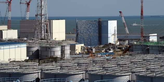 A coast guard vessel (back R) patrols the waters off the Fukushima Daiichi nuclear power plant in Okuma, Fukushima prefecture on October 9, 2015. Tokyo Electric Power Co (TEPCO), which operates the plant in eastern Japan, held a foreign press tour to the crippled Fukushima nuclear power plant on October 9 showing flange tanks dismantling the site, subdrain pit, relaying tanks, land-side and sea-side impermeable walls.     AFP PHOTO / TOSHIFUMI KITAMURA        (Photo credit should read TOSHIFUMI KITAMURA/AFP/Getty Images)
