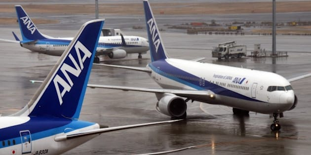 All Nippon Airways (ANA) passenger jets are seen on the runway at Haneda airport in Tokyo on January 29, 2016. ANA on January 29 announced its 9-month profit surged 40 percent as international business expanded.     AFP PHOTO / Toru YAMANAKA / AFP / TORU YAMANAKA        (Photo credit should read TORU YAMANAKA/AFP/Getty Images)