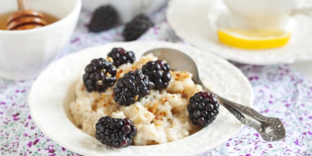 Homemade Oatmeal with Blackberries, granola and honey for Breakfast