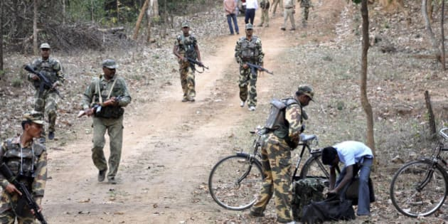 """Indian paramilitary soldiers patrol during an operation under """"Operation Green Hunt"""" near the jungles of Betla, about 210 kilometers (132 miles) northeast of Ranchi, India, Wednesday, March 17, 2010. A major drive has been launched to flush out Maoist rebels, also known as Naxals, from their strongholds in West Bengal and Jharkhand state under the operation. The rebels have fought for more than four decades in several Indian states, demanding land and jobs for agricultural laborers and the poor. About 2,000 people, including police, militants and civilians, have been killed in violence over the past few years. (AP Photo/Sasanka Sen)"""