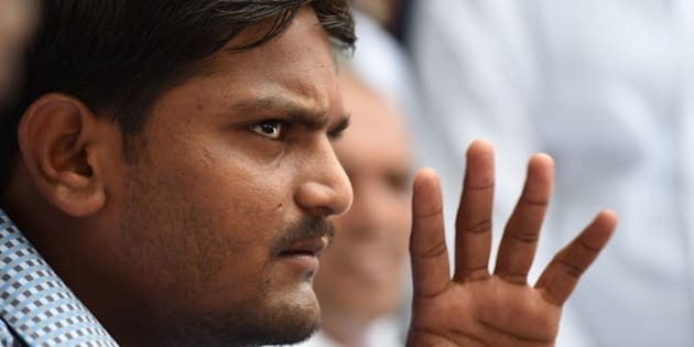 Indian convenor of the 'Patidar Anamat Andolan Samiti', Hardik Patel, who led recent protests in the state of Gujarat demanding preferential treatment regarding jobs and university places for the Patidar caste, speaks during a press conference in New Delhi on August 30, 2015. A firebrand protest leader vowed August 30 to spread agitation over caste preferences nationwide, just days after the worst violence in more than a decade in western India left nine people dead.   AFP PHOTO / SAJJAD HUSSAIN        (Photo credit should read SAJJAD HUSSAIN/AFP/Getty Images)
