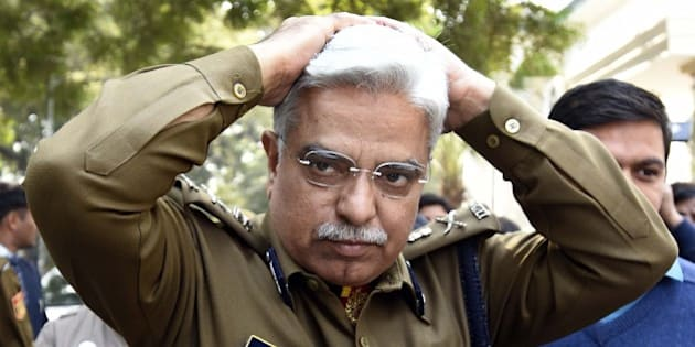 NEW DELHI, INDIA - FEBRUARY 16: Delhi Police Commissioner BS Bassi (Bhim Sain Bassi) arrives for attending the high level meet at Parliament Street Police Station, as Delhi Police officers arrested SAR Geelani, (Syed Abdul Rahman Geelani), former Delhi University lecturer, in connection with the sedition charges for allegedly organising an event at the Press Club of India, on February 16, 2016 in New Delhi, India. Bassi said that the police are probing suspected financial links between terror outfits and students allegedly involved in the raising of anti-India slogans at JNU. (Photo by Sonu Mehta/Hindustan Times via Getty Images)