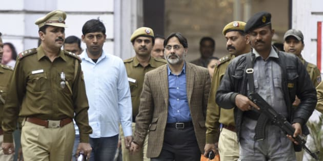 NEW DELHI, INDIA - FEBRUARY 16: Delhi Police officers arrest SAR Geelani (Syed Abdul Rahman Geelani), former Delhi University lecturer, in connection with the sedition charges for allegedly organising an event at the Press Club of India to mark Parliament attack convict Afzal Guru's death anniversary, at Parliament Street Police Station on February 16, 2016 in New Delhi, India. Geelani was detained by police on Monday evening. Geelani had faced trial as Guru's co-accused in the Parliament attack case but was acquitted by the Delhi High Court, a ruling that was later upheld by the Supreme Court. Mr. Geelani, who was acquitted in the 2001 Parliament attack case, was roughed up allegedly by ABVP members on the Jawaharlal Nehru University campus on Wednesday night. Mr. Geelani had arrived there to deliver a talk on Kashmir issues. (Photo by Sonu Mehta/Hindustan Times via Getty Images)