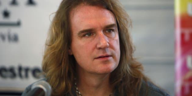 David Ellefson, member the US trash metal band 'Megadeth', looks on during a news conference in La Paz, Bolivia, Friday, Nov. 25, 2011. Megadeth will perform Friday in La Paz. (AP Photo/Juan Karita)