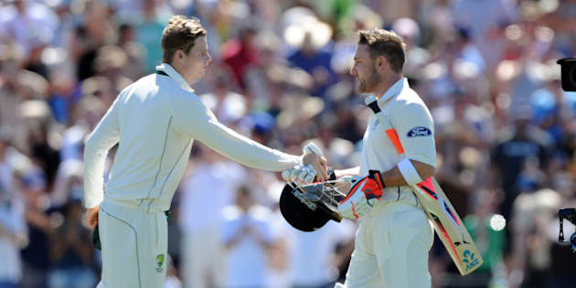 New Zealand's captain Brendon McCullum, right, shakes hands with Australia's captain Steve Smith as he makes his way to the crease in his final test on the first day of the second International Cricket Test match at Hagley Park Oval in Christchurch, New Zealand, Saturday Feb. 20, 2016. (Ross Setford/SNPA via AP) NEW ZEALAND OUT