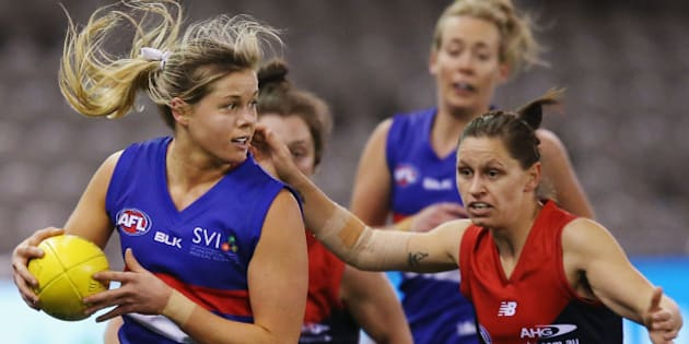 MELBOURNE, AUSTRALIA - AUGUST 16:  Katie Brennan of the Bulldogs looks upfield during a Women's AFL exhibition match between Western Bulldogs and Melbourne at Etihad Stadium on August 16, 2015 in Melbourne, Australia.  (Photo by Michael Dodge/Getty Images)