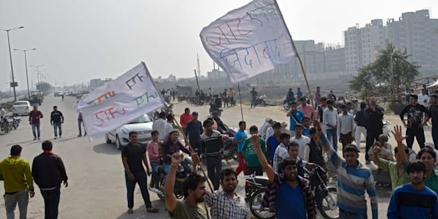 BAHADURGARH, INDIA - FEBRUARY 20: Jat community members protest demanding reservation in government services on February 20, 2016 in Bahadurgarh, India. A mob of around 10,000 people carrying weapons from the surrounding villages of Rohtak were also seen vandalising private property. Police and army have not been able to reach the area as yet. At least one person was killed and 20 others were injured on Saturday in Haryana's Jhajjar after Indian Army personnel fired on Jat protestors, demanding reservation in jobs and education, turned violent and tried to set government buildings on fire. Jat leaders rejected the offer made by the state government and said that the stir would continue till their demand is met. (Photo by Ravi Choudhary/Hindustan Times via Getty Images)