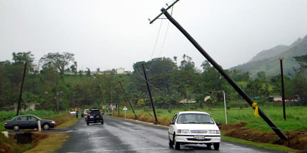 NADUNA, FIJI - MARCH 16  :  (EUROPE AND AUSTRALASIA OUT) Poles carrying power lines lean precariously along Vaturekuka road in Labasa, Fiji, after Cyclone Tomas struck the Pacific island group. The category four cyclone struck Fiji's eastern Lau group of islands, with winds averaging 175 kilometres an hour. (Photo by Theresa Ralogaivau/Newspix/Getty Images)