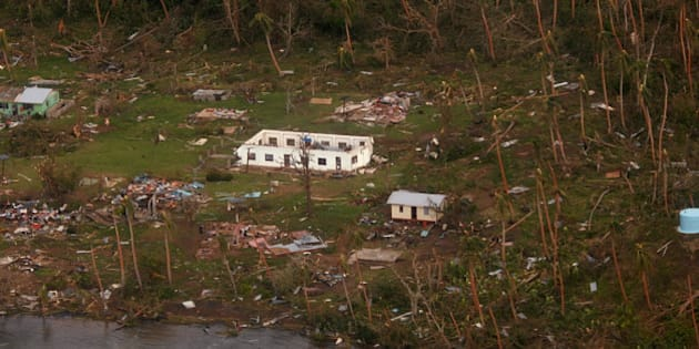 In this Sunday, Feb. 21, 2016 aerial photo supplied by the New Zealand Defense Force, debris is scattered around damaged buildings at Muamua on Vanua Blava Island in Fiji, after Cyclone Winston tore through the island nation. Fijians were finally able to venture outside Monday after authorities lifted a curfew but much of the country remained without electricity in the wake of a ferocious cyclone that left at least six people dead and destroyed hundreds of homes. (New Zealand Defense Force via AP) EDITORIAL USE ONLY