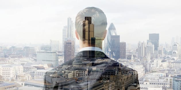 Double exposure of a business man looking towards the financial district of the City  of London with the Heron Tower, Tower 42 and the Gherkin.