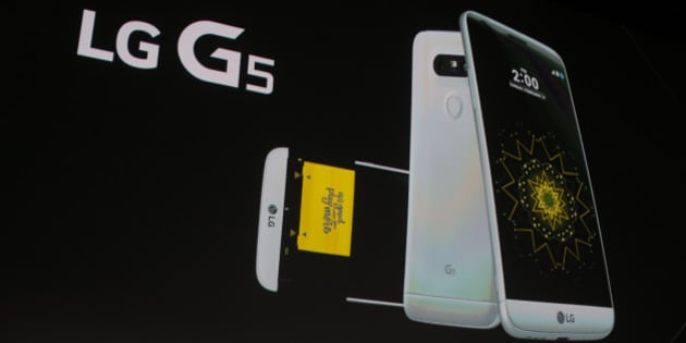 Juno Cho President and CEO of LG Corp. presents the new LG's G5 smartphone during the LG unpacked 2016 event on the eve of this week's Mobile World Congress wireless show, in Barcelona, Spain, Sunday, Feb. 21. 2016. (AP Photo/Manu Fernandez)
