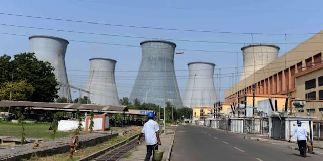 Indian workers walk on the campus of the Wanakbori thermal power plant at Wanakbori village, some 120 kms from Ahmedabad on October 15, 2015.    Gujarat state Chief Minister Anandiben Patel laid the foundation stone for an 800 mega watt (MW) super critical coal-based thermal power plant, to be set up by the Bharat Heavy Electricals Limited (BHEL) at Wanakbori in Kheda district of Gujarat state.   AFP PHOTO / Sam PANTHAKY        (Photo credit should read SAM PANTHAKY/AFP/Getty Images)