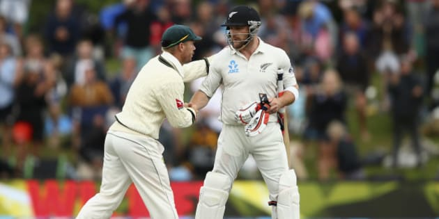 CHRISTCHURCH, NEW ZEALAND - FEBRUARY 22:  Brendon McCullum of New Zealand is congraulated by David Warner of Australia as he walks from the ground after his final test innings during day three of the Test match between New Zealand and Australia at Hagley Oval on February 22, 2016 in Christchurch, New Zealand.  (Photo by Ryan Pierse/Getty Images)