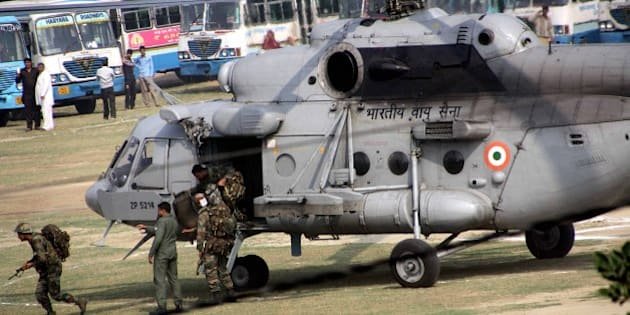 ROHTAK, INDIA - FEBRUARY 21: Army personnel get down from a helicopter at the Police Lines to handle the situation as Jat community protests for reservation in government services, on February 21, 2016 in Rohtak, India. Jat protests demanding reservation under OBC category have taken on a caste colour with violence erupting across Haryana. Reports from Rohtak indicate that Jat protestors looted and vandalised properties owned by people from other castes. Jat leaders rejected the offer made by the state government and said that the stir would continue till their demand is met. (Photo by Manoj Dhaka/Hindustan Times via Getty Images)