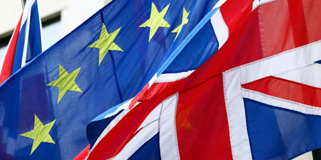 A European Union (EU) flag, center, flies in between two British Union flags, commonly known as a Union Jacks, in London, U.K., on Wednesday, Feb. 17, 2016. German Chancellor Angela Merkel threw her political muscle behind the push for a deal to keep the U.K. in the European Union as diplomats worked to bridge the remaining differences between its members. Photographer: Chris Ratcliffe/Bloomberg via Getty Images