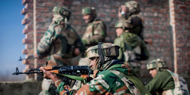 SRINAGAR, KASHMIR, INDIA - FEBRUARY 21: Indian army take soldiers take position near the gun battle site on February 21, 2016 in Srinagar, the summer capital of Indian administered Kashmir, India. Five personnel of Indian government forces including an Indian Army captain and a Kashmiri civilian have been killed so far in the gun battle that entered second day on Sunday amid heavy exchange of  firing between Indian forces and militants holed up inside a government building on the outskirts of Srinagar. (Photo by Yawar Nazir/Getty Images)