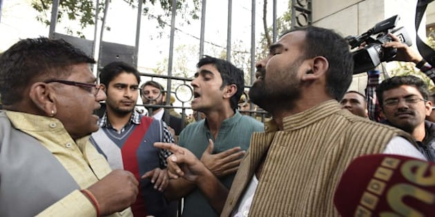 NEW DELHI, INDIA - FEBRUARY 15: JNU and AISA activists leave Patiala House premises after the clash with lawyers, on February 15, 2016 in New Delhi, India. A group of lawyers allegedly thrashed protesters and journalists inside the Patiala House Court premises on Monday afternoon. The students and journalists had gone to the court for the bail hearing of JNUSU President Kanhaiya Kumar, who has been arrested on charges of sedition for allegedly raising anti-India slogans. The escalating stand-off over the arrest of Kanhaiya Kumar on sedition charges today saw the students going on strike demanding his immediate release. Scuffle broke out in Patiala House court when JNUSU President Kanhaiya Kumar was being produced. The court ruled that JNUSU President Kanhaiya Kumar will stay in custody for two more days. (Photo by Sonu Mehta/Hindustan Times via Getty Images)