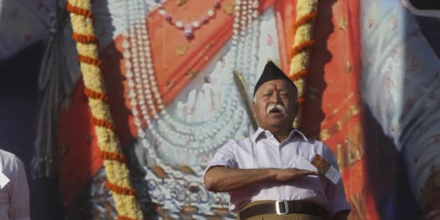 A member of the Hindu nationalist Rashtriya Swayamsevak Sangh (RSS) or the National Volunteers Association chief Mohan Bhagwat offers prayers during a daylong camp on the outskirts of Pune, Maharashtra state, India, Sunday, Jan. 3, 2016. Hindus, make up more than 80 percent of India's population of 1.25 billion. (AP Photo/Rafiq Maqbool)