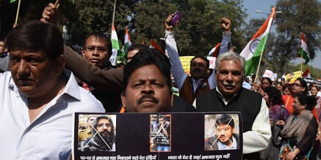 NEW DELHI, INDIA - FEBRUARY 21: Thousands of people including ex-servicemen take out a unity march against 'anti-national' activities in Jawaharlal Nehru University Campus over the hanging of 2001 Parliament attack convict Afzal Guru,  from Rajghat to Jantar Mantar near Mandi House on February 21, 2016 in New Delhi, India. The protest was organised under the banner 'March For Unity To Save The Country'. JNU has been on the boil over the arrest of its student's Union President Kanhaiya Kumar on sedition charges after some students organised a meet to mark the anniversaries of executions of Parliament attack convict Afzal Guru. Delhi's Patiala House Court on Wednesday sent JNU student union leader Kanhaiya Kumar to judicial custody till March 2. (Photo by Sushil Kumar/Hindustan Times via Getty Images)