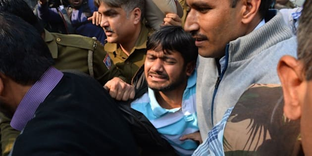 Indian student union leader Kanhaiya Kumar (C) is escorted by police into Patiala Court for a hearing in New Delhi on February 17, 2016.  Student union leader Kanhaiya Kumar had been arrested for allegedly shouting anti-India slogans at a rally called to protest against a Kashmiri separatist's execution three years ago -- a charge he denies. His arrest has reignited a row over freedom of expression in India, where some rights campaigners say the Hindu nationalist government is using the British-era sedition law to clamp down on dissent. AFP PHOTO / CHANDAN KHANNA / AFP / Chandan Khanna        (Photo credit should read CHANDAN KHANNA/AFP/Getty Images)
