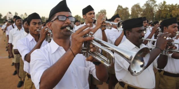 Members of Hindu nationalist Rashtriya Swayamsevak Sangh (RSS) or the National Volunteers Association brass band perform during the concluding event of their four day camp in Bangalore, India, Sunday, Jan. 10, 2016. About 2000 RSS members who can play brass band instruments participated in the event. Hindus, make up more than 80 percent of India's population of 1.25 billion. (AP Photo/Aijaz Rahi)