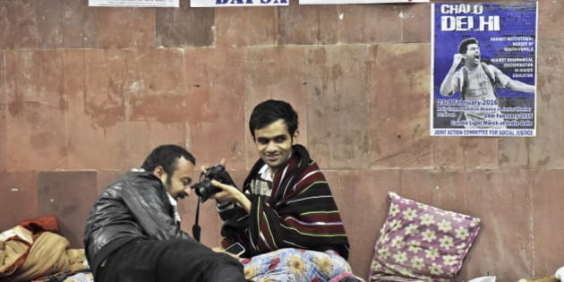 NEW DELHI, INDIA - FEBRUARY 23: JNU Student Umar Khalid at JNU Campus on night of February 23, 2016 in New Delhi, India.  Five JNU students Umar Khalid, Anant Prakash Narayan, Ashutosh Kumar, Rama Naga and Anirban Bhattacharya accused of sedition reappeared on the campus on Sunday, having spent 10 days in hiding.  The five students are accused of allegedly planning an event on February 9 against the hanging of Parliament attack convict Afzal Guru, where anti-national slogans were allegedly shouted. (Photo by Sanjeev Verma/ Hindustan Times via Getty Images)